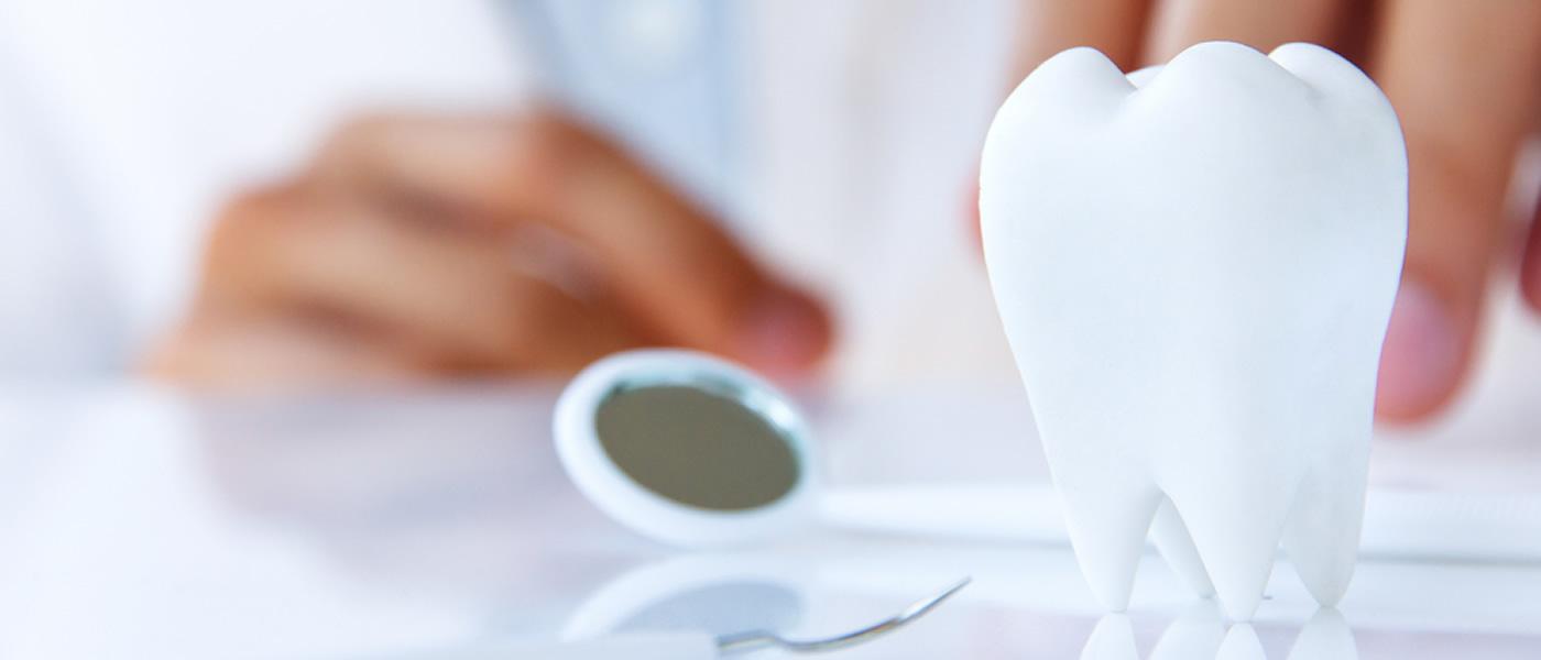 Dental deposit scaling